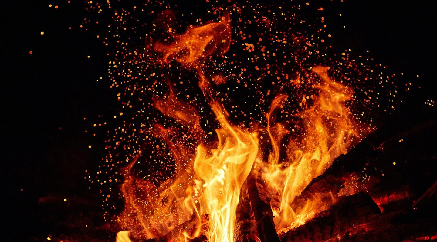 flames, sparks and embers burn into the black background